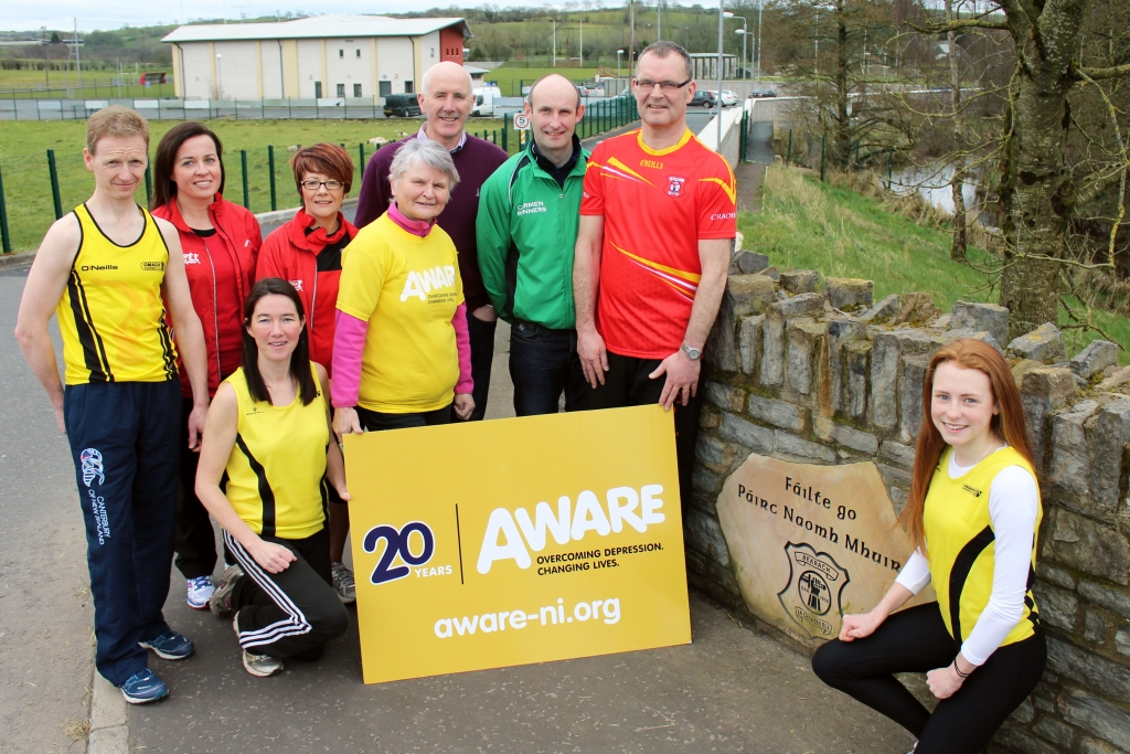 Looking ahead to the Beragh 5 on April 9 are (L-R): Niall Heaney, Dervla Devlin, Kate Corrigan, Margaret McCrossan (Aware), Hugh McNamee (club chairman), Darryl Meenagh and Adrian Donnelly (race co-ordinator). Front: Aileen McCann and Niamh Heaney.